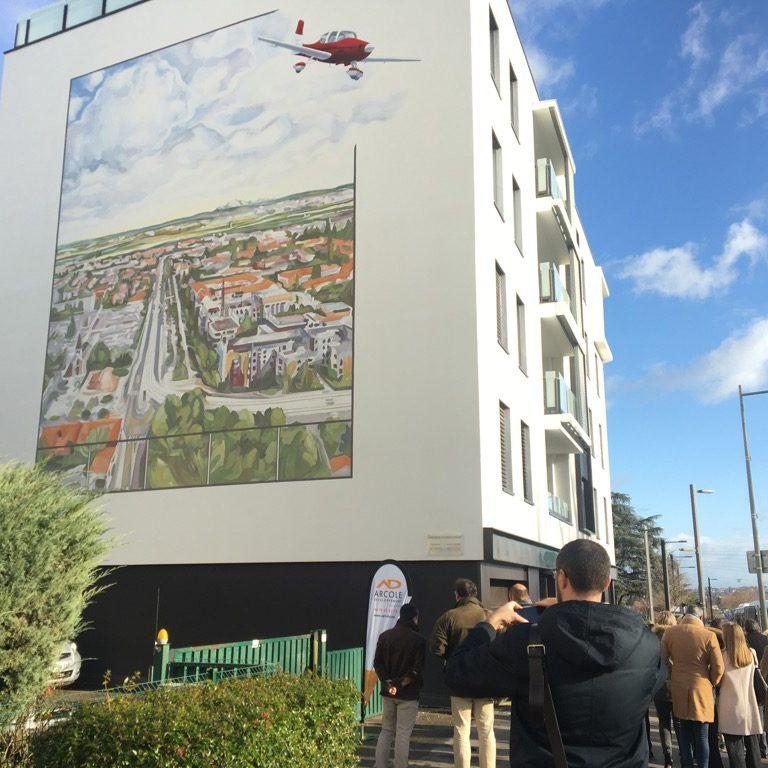 """Fresque murale """"Un paysage à la Turner sur la plaine de Bron"""", conçue par CitéCréation pour le compte du promoteur immobilier Arcole"""